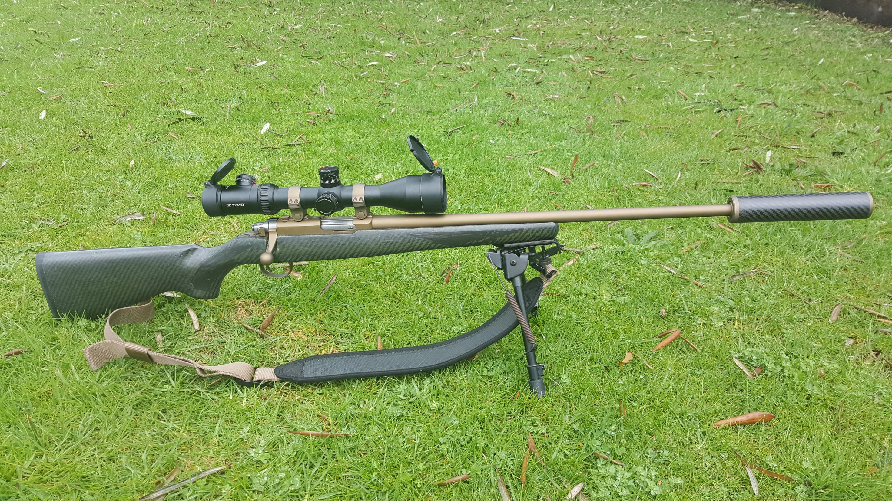 Name:  Ruger 77-22 .22 WMR Cerakoted SS Stug Carbon Stock 2.5-10x44 Vortex Viper PST 1.jpg