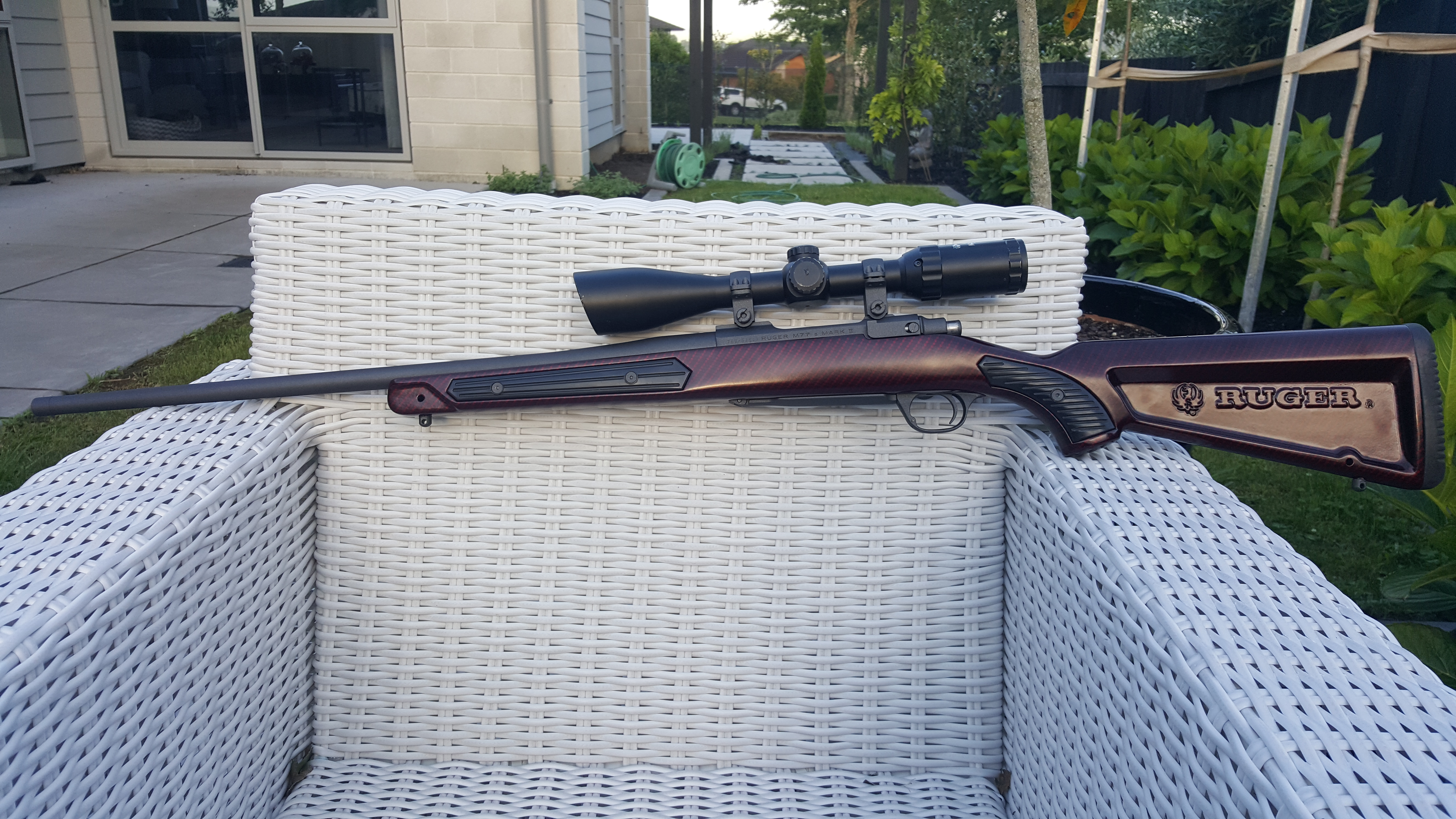 Name:  Ruger M77 MkII 7mm08 Hydro Cobalt w Red Cherry Carbon Skekton Stock 4.jpg Views: 103 Size:  4.11 MB