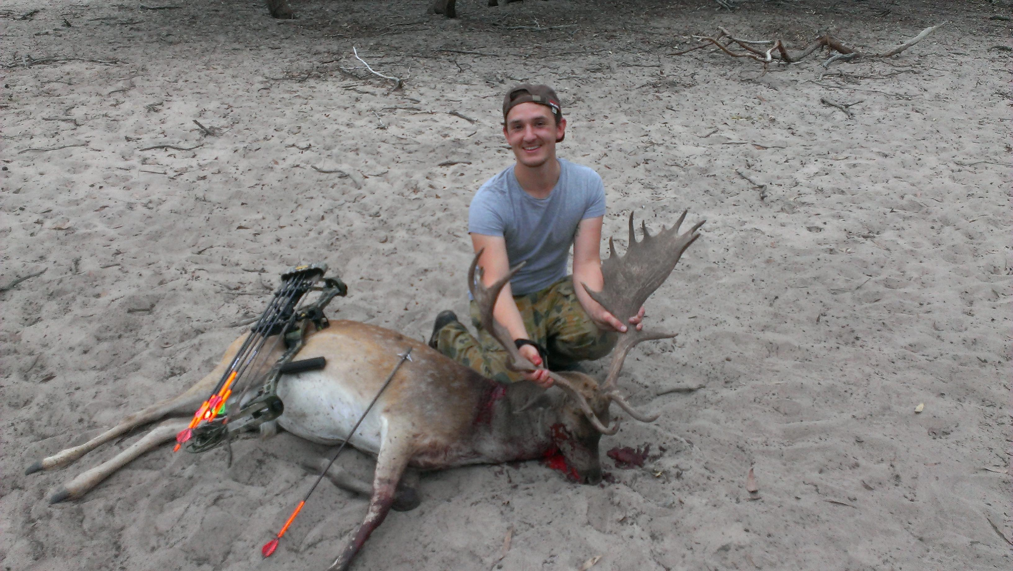 Name:  First buck with bow 2.jpg