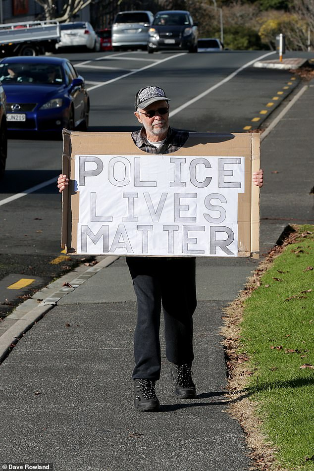 Name:  29840646-8450067-A_member_of_hold_a_police_lives_matter_sign_outside_Henderson_Po-a-15_159290515.jpg Views: 323 Size:  168.2 KB
